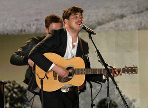 Photo - Marcus Mumford performs a tribute to Levon Helm at the 55th annual Grammy Awards on Sunday, Feb. 10, 2013, in Los Angeles. (Photo by John Shearer/Invision/AP)