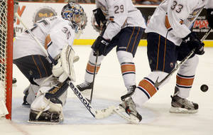 photo - Yann Danis of the Oklahoma City Barons watches the puck during a hockey game at the Cox Convention Center in Oklahoma City, Friday, April 13, 2012. Photo by Bryan Terry, The Oklahoman