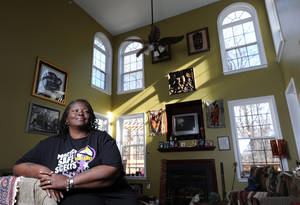 Photo - Deatrice S. Besong is shown in her home in Upper Marlboro, Md. Bank of America has agreed to reduce her mortgage principal. MCT PHOTO