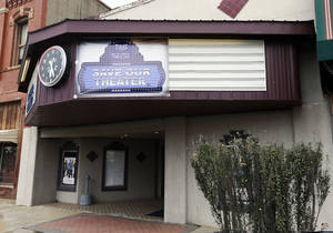 Photo - FILE PHOTO: The community of Stigler has raised more than $100,000 to convert the Time Theater to digital. <strong>NATE BILLINGS - NATE BILLINGS</strong>