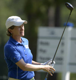 Photo - Catriona Matthew watches the flight of her tee shot on the ninth hole in the second round of the Airbus LPGA Classic golf tournament at Magnolia Grove on Friday, May 23, 2014, in Mobile, Ala. (AP Photo/G.M. Andrews)