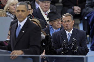 photo - Speaker John Boehner of Ohio listen as President Barack Obama delivers his Inaugural address at the ceremonial swearing-in at the U.S. Capitol during the 57th Presidential Inauguration in Washington, Monday, Jan. 21, 2013. (AP Photo/Carolyn Kaster)