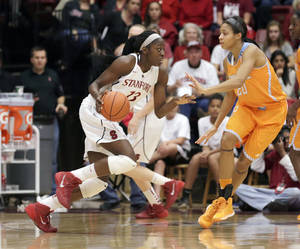 Photo - Stanford forward Chiney Ogwumike (13) looks to drive the ball against Tennessee center Isabelle Harrison (20) during the first half of an NCAA women's college basketball game, Saturday, Dec. 21, 2013, in Stanford, Calif. (AP Photo/Tony Avelar)