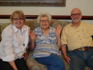 Photo - Alice M. Scott sits with her son and daughter-in-law, Marge and Harry Mason. Photo provided by Catlin Cairns