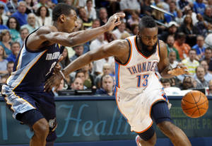 photo - Oklahoma City's James Harden (13) drives the ball against Memphis' Tony Allen (9) during the NBA basketball game between the Memphis Grizzlies and the Oklahoma City Thunder at Chesapeake Energy Arena in Oklahoma City, Monday, April 2, 2012. Memphis won 94-88. Photo by Nate Billings, The Oklahoman