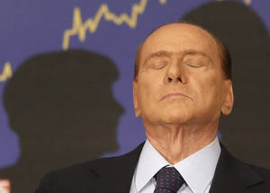 Photo -   FILE - In this Sept. 27, 2012 file photo, Italian former premier Silvio Berlusconi reacts during a press conference in Rome, Italy. A court in Italy has convicted, Friday, Oct. 26, 2012, former Premier Silvio Berlusconi of tax fraud and sentenced him to four years in prison. In Italy, cases must pass two levels of appeal before the verdicts are final. Berlusconi is expected to appeal. (AP Photo/Alessandra Tarantino, File)