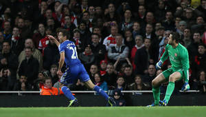 Photo - Chelsea's Cesar Azpilicueta, left, turns away to celebrate after scoring the opening goal during their English League Cup soccer match between Arsenal and Chelsea at the Emirates stadium in London Tuesday, Oct. 29, 2013. (AP Photo/Alastair Grant)