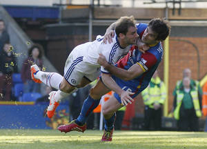 Photo - Crystal Palace's Mile Jedinak, right, tussles with Chelsea's Branislav Ivanovic during their English Premier League soccer match at Selhurst Park, London, Saturday, March 29, 2014. (AP Photo/Sang Tan)