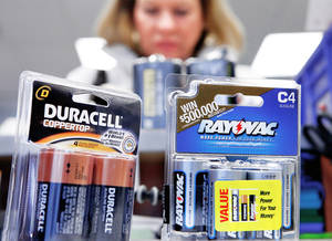 Photo - A customer purchases batteries Thursday at Batteries Plus at NW 63 and May Avenue.  Photo by Jim Beckel, The Oklahoman