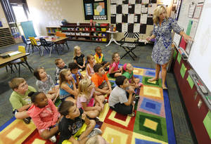 Photo - Allison Cockerell teaches her second-grade class at John Ross Elementary School in Edmond. Photo By Steve Gooch, The Oklahoman <strong>Steve Gooch - The Oklahoman</strong>