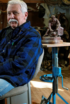 photo - Surrounded by his work, family pictures and other western memorabilia, artist Harold Holden talks about his artwork at his studio in Kremlin, Okla., on Thursday, Jan. 20, 2011. Photo by John Clanton, The Oklahoman