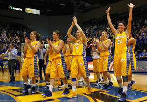 Photo - South Dakota State head coach Aaron Johnston, far left, celebrates and thanks the home crowd for their support at the end of an NCAA college basketball game in the quarterfinals of the WNIT, Sunday, March 30, 2014, in Brookings, S.D. South Dakota State defeated Indiana 76-64. (AP Photo/Eric Landwehr)