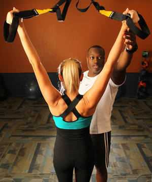 Photo - Andrea Robertson and Robert Bishop model fashionable workout wear. Studies have shown that sweating in style, or dressing like a professional athlete, can enhance performance. (Christian Gooden/St. Louis Post-Dispatch/MCT)