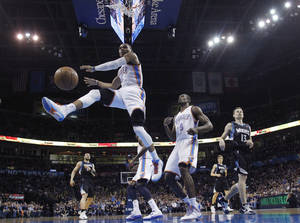 Photo - Oklahoma City Thunder guard Russell Westbrook (0) watches the ball after a dunk against the Minnesota Timberwolves duiring the first quarter of an NBA basketball game in Oklahoma City, Friday, Feb. 22, 2013. (AP Photo/Sue Ogrocki)