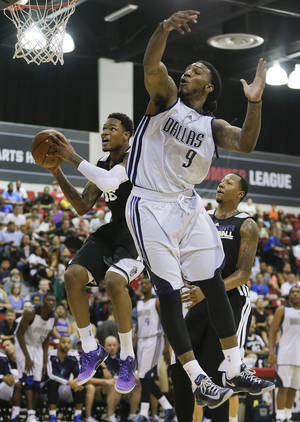 Photo - Sacramento Kings Ben McLemore, left, goes up for a shot against Dallas Mavericks Jae Crowder in the third quarter of an NBA Summer League basketball game, Saturday, July 13, 2013, in Las Vegas. (AP Photo/Julie Jacobson)