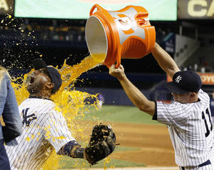 Photo - New York Yankees' Brett Gardner (11) douses shortstop Eduardo Nunez after their 6-4 win over the Chicago White Sox in a baseball game at Yankee Stadium, Tuesday, Sept. 3, 2013, in New York. The Yankees won 6-4. (AP Photo/John Minchillo)