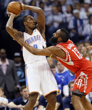 Photo - Oklahoma City's Serge Ibaka (9) keeps the ball away from Houston's James Harden (13) during Game 2 in the first round of the NBA playoffs between the Oklahoma City Thunder and the Houston Rockets at Chesapeake Energy Arena in Oklahoma City, Wednesday, April 24, 2013. Photo by Nate Billings, The Oklahoman