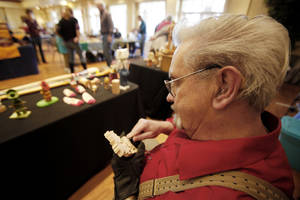 Photo - Larry MacCarron uses his hands to turn a piece of wood into artwork at the Edmond Senior Center Woodcarving Show. PHOTO BY STEVE GOOCH, THE OKLAHOMAN. <strong>STEVE GOOCH. - THE OKLAHOMAN</strong>
