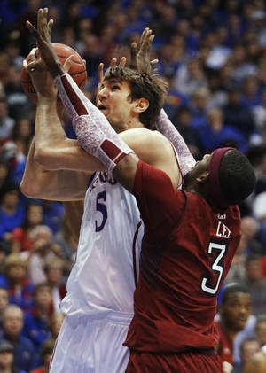 Photo - Kansas center Jeff Withey (5) shoots while covered by Temple Owls forward Anthony Lee (3) during the first half of an NCAA college basketball game in Lawrence, Kan., Sunday, Jan. 6, 2013. (AP Photo/Orlin Wagner)