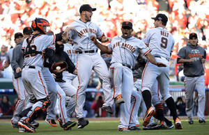 Photo -   The San Francisco Giants celebrate after they defeated the Cincinnati Reds 6-4 in Game 5 of the National League division baseball series, Thursday, Oct. 11, 2012, in Cincinnati. The Giants won the final three games, all in Cincinnati, and advanced to the NL championship series. (AP Photo/Michael Keating)