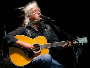 Photo - Arlo Guthrie performs during the Woody Guthrie Folk Festival in Okemah. Photo by Bryan Terry, The Oklahoman