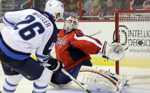 Photo - Winnipeg Jets right wing Blake Wheeler (26) watches his shot go past Washington Capitals goalie Braden Holtby (70) for a goal in the second period of an NHL hockey game Tuesday, Jan. 22, 2013 in Washington. (AP Photo/Alex Brandon)
