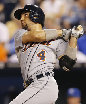 Photo - Detroit Tigers' Omar Infante hits a three-run double off Kansas City Royals relief pitcher Luis Mendoza during the fifth inning of a baseball game at Kauffman Stadium in Kansas City, Mo., Friday, Sept. 6, 2013. (AP Photo/Orlin Wagner)