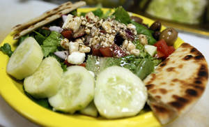Photo - The side Greek salad at Simply Falafel, 343 S. Blackwelder, in Edmond. Photo by Nate Billings, The Oklahoman <strong>NATE BILLINGS - NATE BILLINGS</strong>
