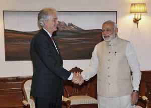 Photo - India's Prime Minister Narendra Modi, right, shakes hands with U.S. Deputy Secretary of State William Joseph Burns during a meeting at prime minister's residence in New Delhi, India, Friday, July 11, 2014. Burn arrived Thursday on a two day official visit to India. (AP Photo/Harish Tyagi, Pool)