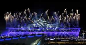 Photo - Fireworks illuminate the sky over the Olympic Stadium during the Opening Ceremony of the 2012 Summer Olympics, Saturday, July 28, 2012, in London. (AP Photo/Dave Martin) ORG XMIT: OLYDM301