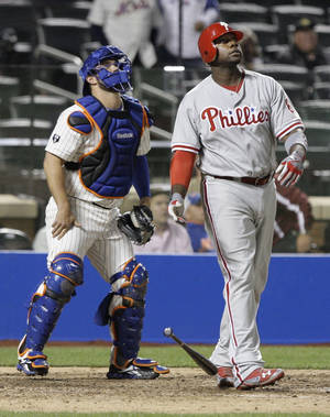 Photo -   Philadelphia Phillies' Ryan Howard, right, drops his bat after hitting a home run as New York Mets catcher Kelly Shoppach watches the ball during the ninth inning of a baseball game on Wednesday, Sept. 19, 2012, in New York. (AP Photo/Frank Franklin II)