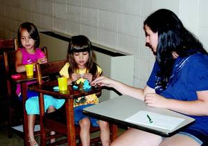 Photo - Participants in the Bring It To Life summer camp at Northeastern State University learn about a story's plot, setting and conflict. (Tahlequah Daily Press photo)