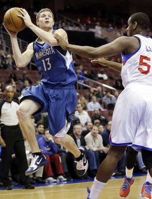 Photo - Minnesota Timberwolves' Luke Ridnour (13) shoots against Philadelphia 76ers' Lavoy Allen in the first half of an NBA basketball game, Tuesday, Dec. 4, 2012, in Philadelphia. (AP Photo/Matt Slocum)