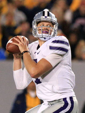 Photo -   Kansas State quarterback Collin Klein looks to pass during an NCAA college football game against West Virginia in Morgantown, W.Va., Saturday, Oct. 20, 2012. Kansas State won 55-14. (AP Photo/Christopher Jackson)