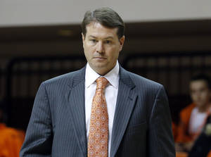Photo - Oklahoma State head coach Travis Ford coaches during the college basketball game between Oklahoma State University and Ottawa (Kan.) at Gallagher-Iba Arena in Stillwater, Okla., Thursday, Nov. 1, 2012. Photo by Sarah Phipps, The Oklahoman