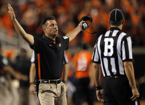 Photo - Oklahoma State head coach Mike Gundy argues a call during a college football game between Oklahoma State University (OSU) and the University of Texas (UT) at Boone Pickens Stadium in Stillwater, Okla., Saturday, Sept. 29, 2012. Texas won 41-36. Photo by Sarah Phipps, The Oklahoman