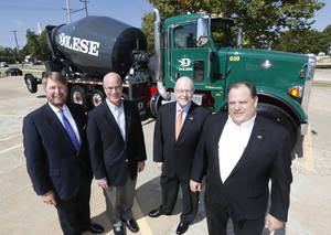 Photo - Guy Patton, left, The University of Oklahoma Foundation President, Mark Helm, President of Dolese Brothers, Kirk Jewell, President & Chief Executive Officer, Oklahoma State University Foundation & Bill Schlittler, CFO, Dolese Brothers pose in front of a truck in Oklahoma City. <strong>Steve Gooch - The Oklahoman</strong>