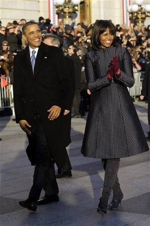 Photo - President Barack Obama and first lady Michelle Obama walk in the Inaugural Parade during the 57th Presidential Inauguration in Washington, Monday, Jan. 21, 2013. (AP Photo/Charles Dharapak)
