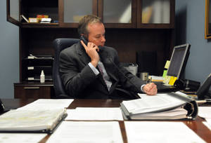 Photo -   Marvin McFadyen, Board of Elections director for New Hanover County, makes a call from his office in Wilmington, N.C., Tuesday, Nov. 6, 2012. (AP Photo/The Star-News, Paul Stephen)