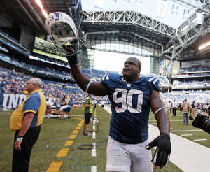 Photo -   Indianapolis Colts' Cory Redding (90) gestures as he leaves the field after the Colts defeated the Minnesota Vikings 23-20 in an NFL football game in Indianapolis, Sunday, Sept. 16, 2012. (AP Photo/AJ Mast)