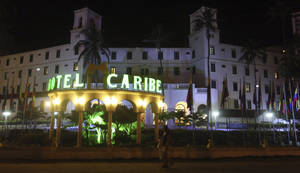 photo -   People walk past Hotel El Caribe in Cartagena, Colombia, late Thursday, April 19, 2012. Eleven Secret Service employees are accused of misconduct in connection with a prostitution scandal at the hotel last week before President Barack Obama's arrival for the Summit of the Americas. The identities of two Secret Service supervisors who have been pushed out of the agency in the wake of the scandal have been revealed. (AP Photo/Pedro Mendoza)