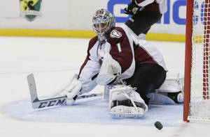 Photo - Colorado Avalanche goalie Semyon Varlamov blocks a shot against the Anaheim Ducks during the second period of an NHL preseason hockey game in Anaheim, Calif., Sunday, Sept. 22, 2013. (AP Photo/Chris Carlson)