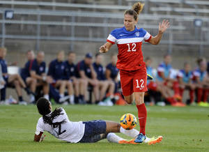 Photo - United States' Lauren Holiday, right, trips over France's Wendie Renard, left, during the first half of a women's friendly soccer match on Thursday, June 19, 2014, in East Hartford, Conn. (AP Photo/Jessica Hill)