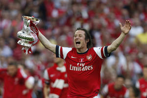 Photo - Arsenal's Tomas Rosicky celebrates with the trophy after their win against Hull City at the end of their English FA Cup final soccer match at Wembley Stadium in London, Saturday, May 17, 2014. (AP Photo/Sang Tan)