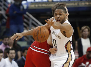 Photo - New Orleans Pelicans guard Eric Gordon (10) steals the ball from Chicago Bulls forward Mike Dunleavy during the first half of an NBA basketball game in New Orleans, Saturday, Feb. 1, 2014.  (AP Photo/Bill Haber)