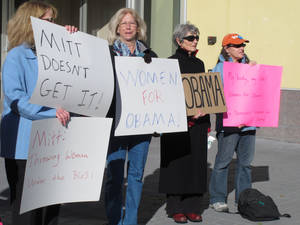 photo -   In this Oct. 24, 2012 photo, women backing President Obama protest outside a convention center in Reno where Republican Mitt Romney was giving a campaign speech. Exit polls show significant support from women was a key factor in Obama's victory over Romney in the key battleground state of Nevada. (AP Photo/Scott Sonner)