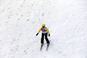 Photo - Brazil's Joselane Santos lands from a jump during the women's freestyle skiing aerials qualifying at the Rosa Khutor Extreme Park, at the 2014 Winter Olympics, Friday, Feb. 14, 2014, in Krasnaya Polyana, Russia. (AP Photo/Andy Wong)