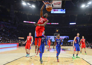 photo - West Team's Kevin Durant of the Oklahoma City Thunder dunks during the first half of the NBA All-Star basketball game Sunday, Feb. 17, 2013, in Houston. (AP Photo/Bob Donnan, Pool) ORG XMIT: HTR170