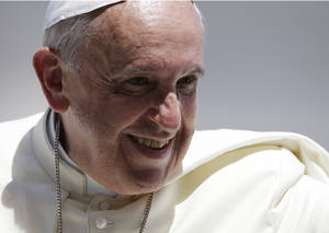 Photo - Pope Francis smiles as he leaves St. Peter's Square following his weekly general audience, at the Vatican, Wednesday, June 4, 2014. (AP Photo/Gregorio Borgia)