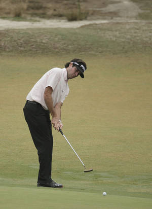 Photo - Bubba Watson putts on the 11th hole during the second round of the U.S. Open golf tournament in Pinehurst, N.C., Friday, June 13, 2014. (AP Photo/Charlie Riedel)